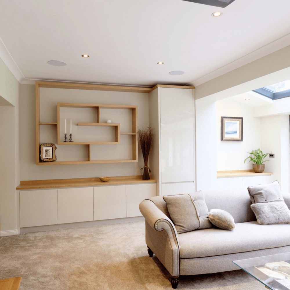 Riverdale bespoke fitted interiors lounge storage and shelving in light oak and cream finish