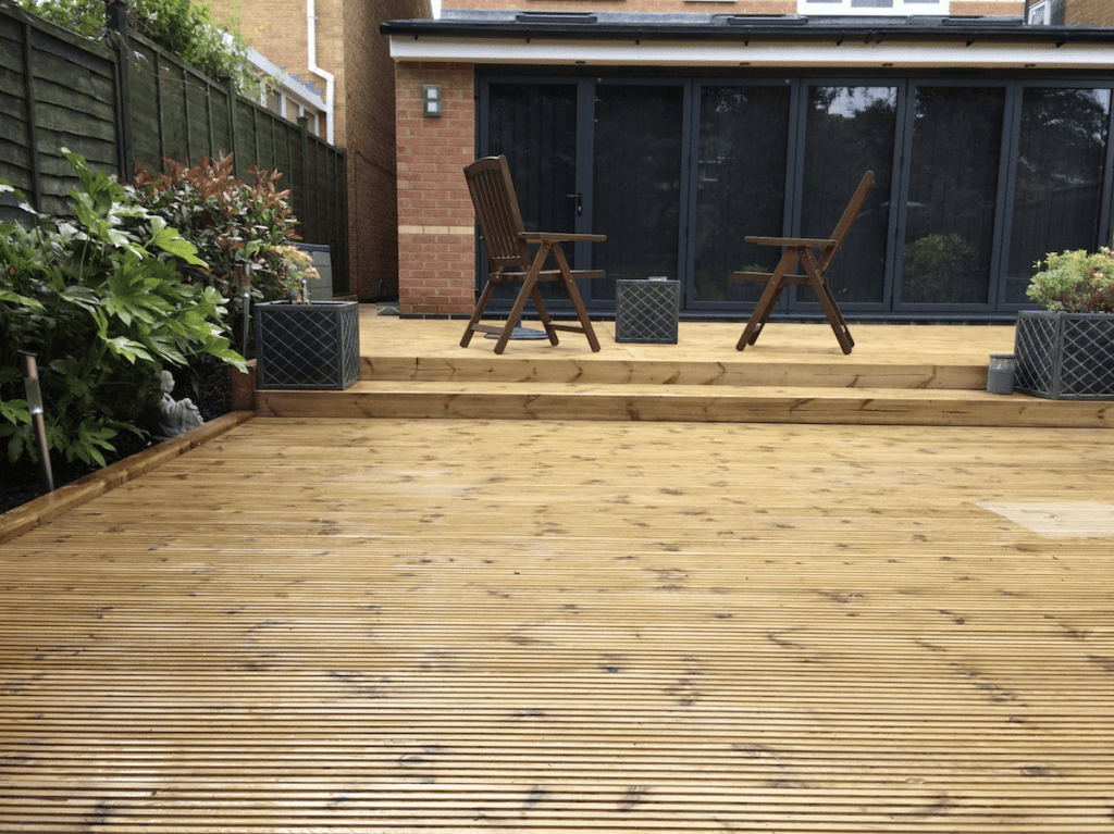 garden decking installers Sheffield light oak wood deck with stepped raised area