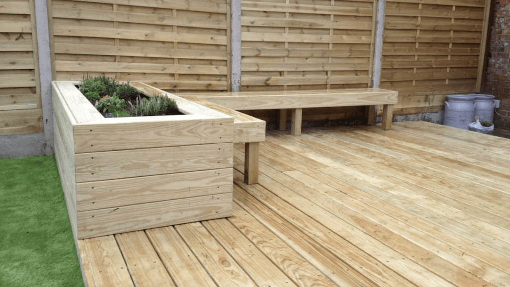 garden decking installers sheffield hardwood decking with seated bench and planters